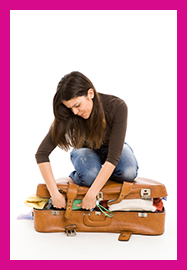 woman-sitting-on-suitcase+5